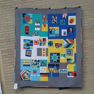 Clothworks Organic Solids Modern Block Challenge Quilt.  Quilted by member Sandie and bound by member Amy