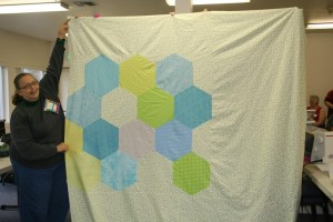 Deborah C and the SEAMQG QuiltCon charity quilt back