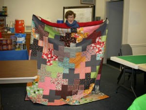 Grace with her Flea Market Fancy Plus quilt
