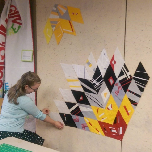 Our Princess of Diamonds arranged a few blocks for our 2016 QuiltCon Charity Challenge quilt